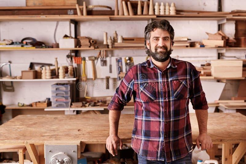 Independent furniture designer and manufacturer in his workshop stock image