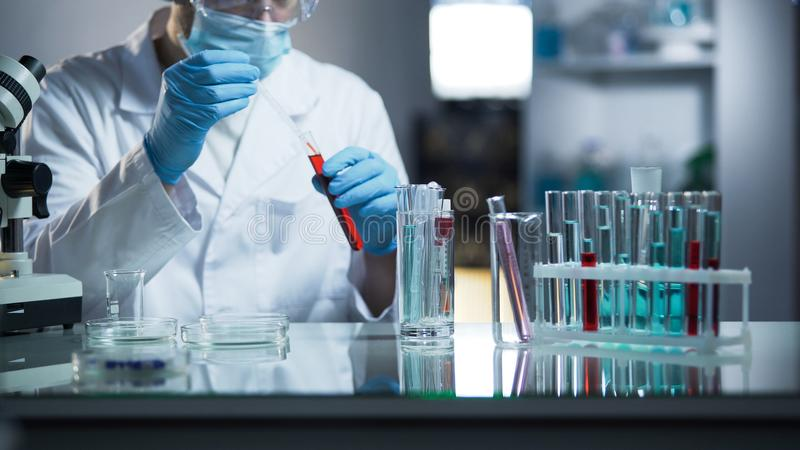 Independent medical laboratory checking athletes blood for presence of steroids royalty free stock image