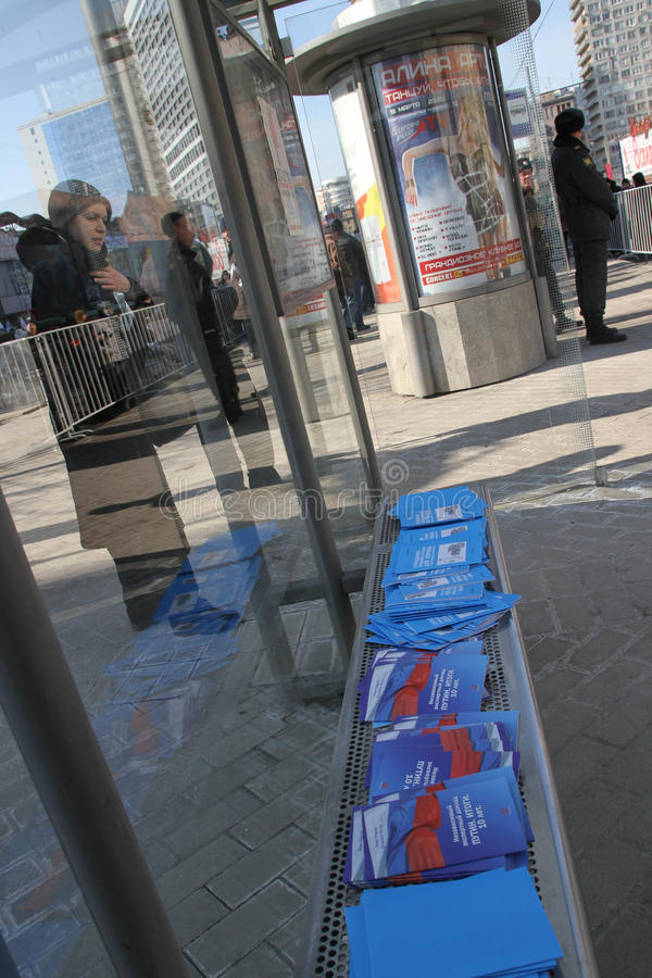 An independent report by Boris Nemtsov Putin Results laid out at the bus stop next to the opposition rally stock photography