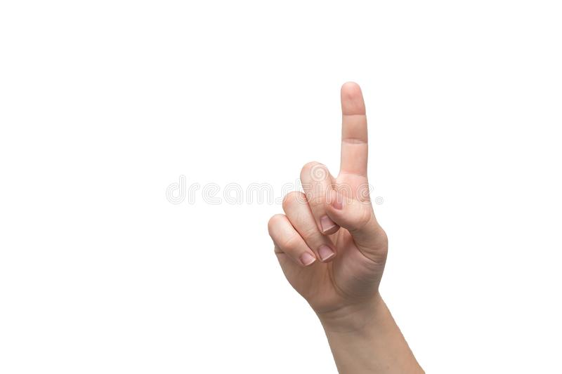 The index finger of a male hand is pointing up isolated on a white background. Sign of attention. The number one stock images