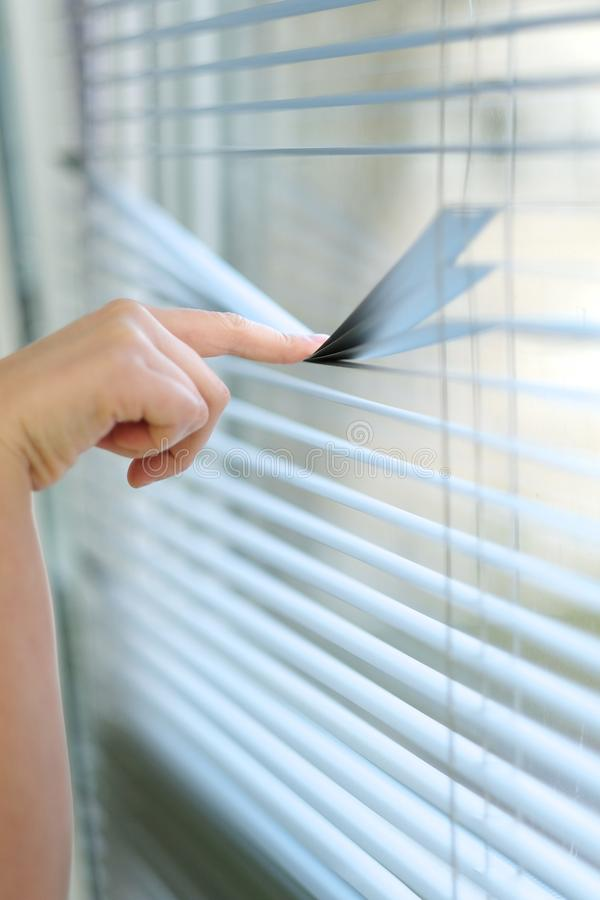 Index finger when pressing the transverse strip blinds stock photo