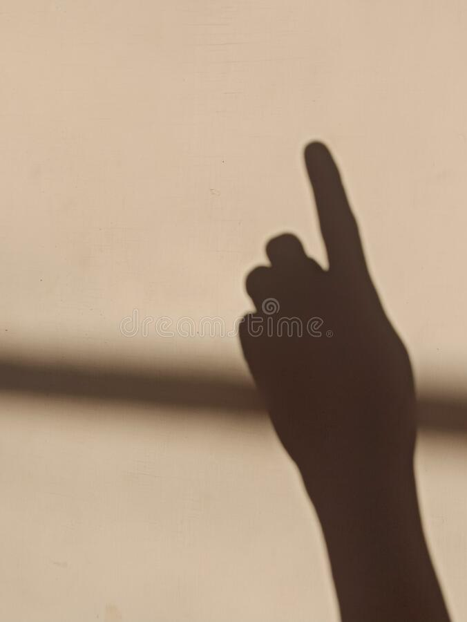 The index finger shadow stock photos