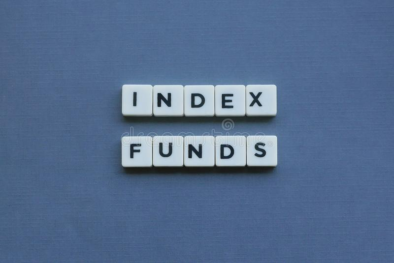 ' Index Funds ' word made of square letter word on grey background. Money, financial, investment, wealth, retirement, finance, income, profit, bond stock image