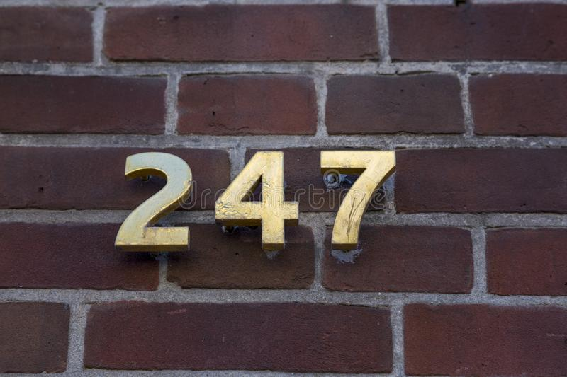 Index with the number 247 on the facade. Of a brick house stock photography