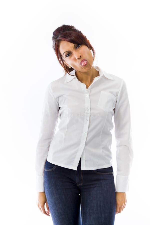 Download Indiańska Młoda Kobieta Szturcha Out Jęzor W Kierunku Kamery Odizolowywającej Na Białym Tle Zdjęcie Stock - Obraz złożonej z obłąkanie, dziecięcy: 41951426