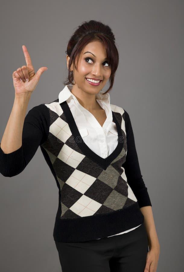 Download Indiański Bizneswoman Ono Uśmiecha Się Upwards I Wskazuje Obraz Stock - Obraz złożonej z zaufanie, potomstwa: 41950635