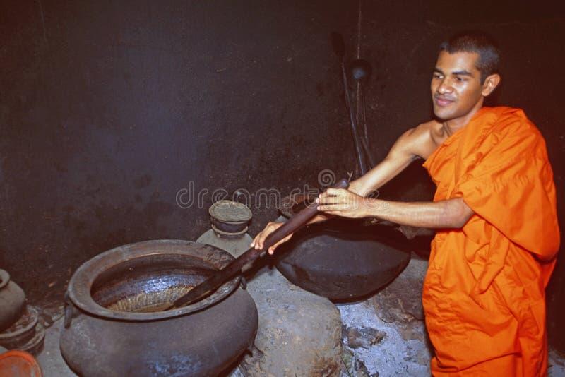 India: A buddhist monk preparing herbal ayurevedic medicinin Thiruvananthapuram, Kerala. India: A buddhist monk preparing herbal ayurevedic medicinin royalty free stock photo