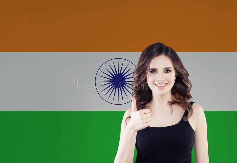 India concept. Happy woman with thumb up on the India flag background. Travel and learn hindi language.  stock photos