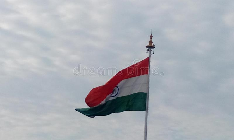 India country flag in a flagpole in front of chennai international airport as an integrity freedom independence symbol. Picture of India country flag in a stock photos