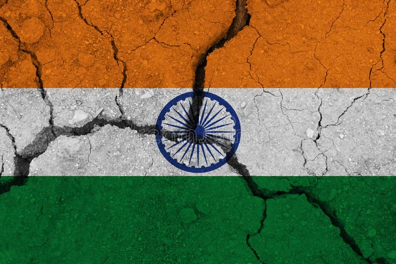 India flag on the cracked earth. National flag of India. Earthquake or drought concept royalty free stock photography
