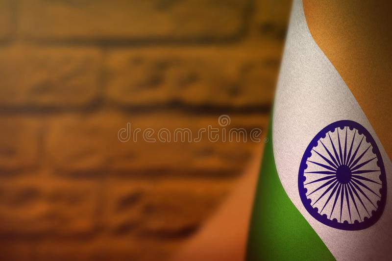 India flag for honour of veterans day or memorial day. Glory to the India heroes of war concept on orange blurred painted brick. India hanging flag for honour of stock images
