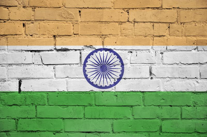 India flag is painted onto an old brick wall royalty free illustration