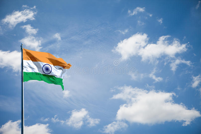 India flag. India or Republic of India, nation flag is waving on blue sky royalty free stock photo