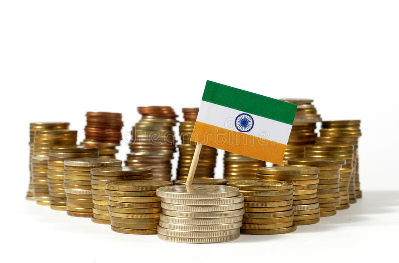 India flag with stack of money coins. India flag waving with stack of money coins stock photography