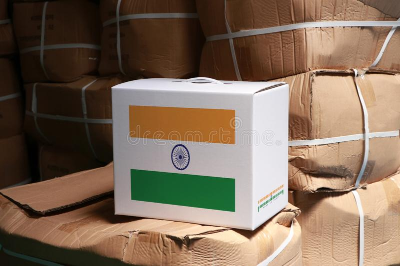 India flag on white box with barcode and the color of nation flag on the stack of brown box. The concept of export trading from. India, paper packaging for put stock photo