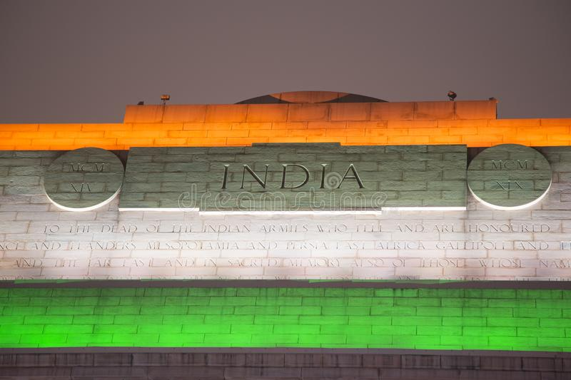 India Gate Lit up in Flag Colors. At the top of the India Gate, a war memorial to Indian soldiers who died in two wars, the orange, white and green colors of the stock images