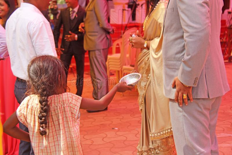 India, GOA, January 28, 2018. Poor child asks money from passers-by, child with outstretched hand, beggar. Poverty in India.  royalty free stock photo