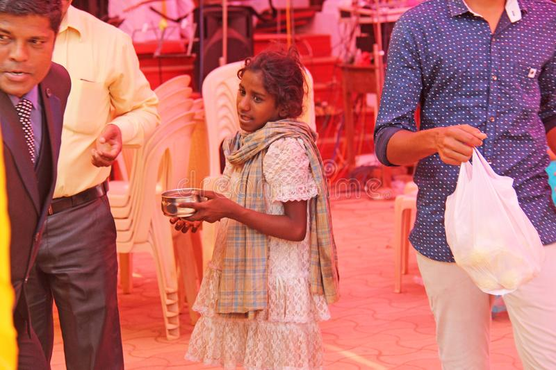India, GOA, January 28, 2018. Poor child asks money from passers-by, child with outstretched hand, beggar. Poverty in India.  stock image