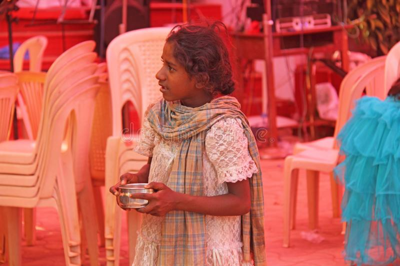 India, GOA, January 28, 2018. Poor child asks money from passers-by, child with outstretched hand, beggar. Poverty in India.  royalty free stock images