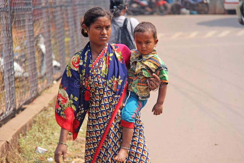 India, GOA, January 28, 2018. Poor Indian woman with a baby in her arms. Poverty in India.  stock photo