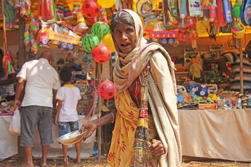 India, GOA, January 28, 2018. Poor woman asks for money on the street in India. A beggar woman with an outstretched hand. Poverty.  royalty free stock photography