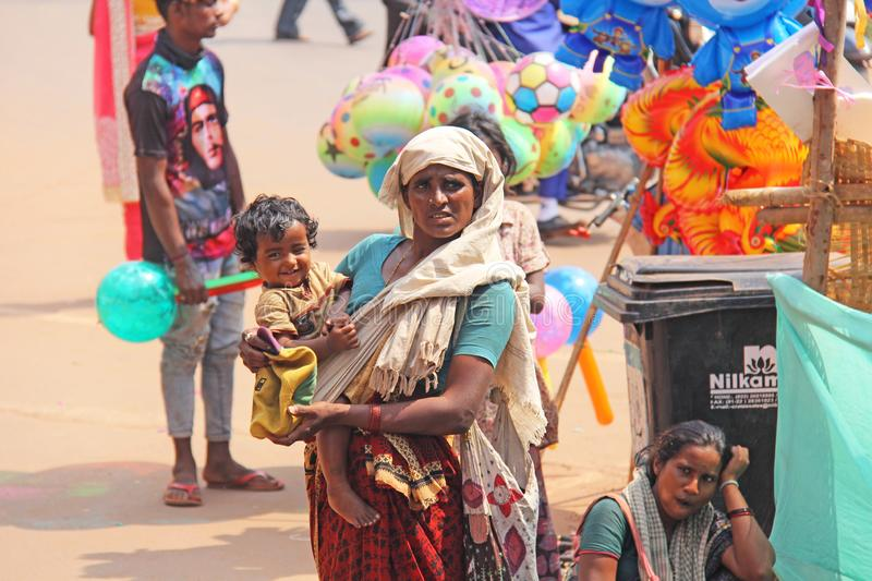 India, GOA, January 28, 2018. Poor woman with a child asks for money on the street in India. A beggar woman with an outstretched. Hand. Poverty royalty free stock images