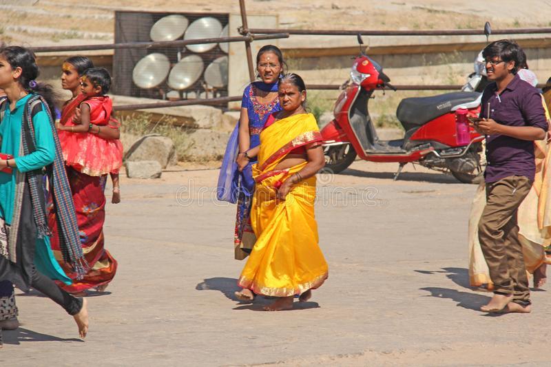 India. Hampi - February 1, 2018. A crowd of Indian men and women in a sari on the streets of India. Bright colors of India. People. Of India and Hampi stock photography