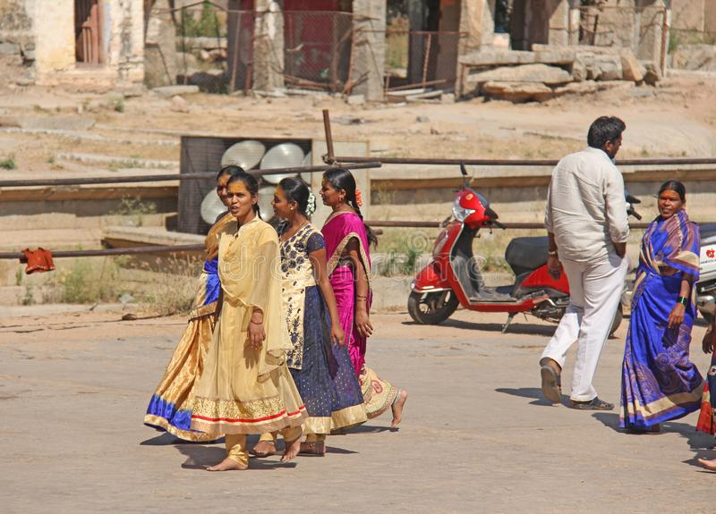 India. Hampi - February 1, 2018. A crowd of Indian men and women in a sari on the streets of India. Bright colors of India. People. Of India and Hampi stock photo