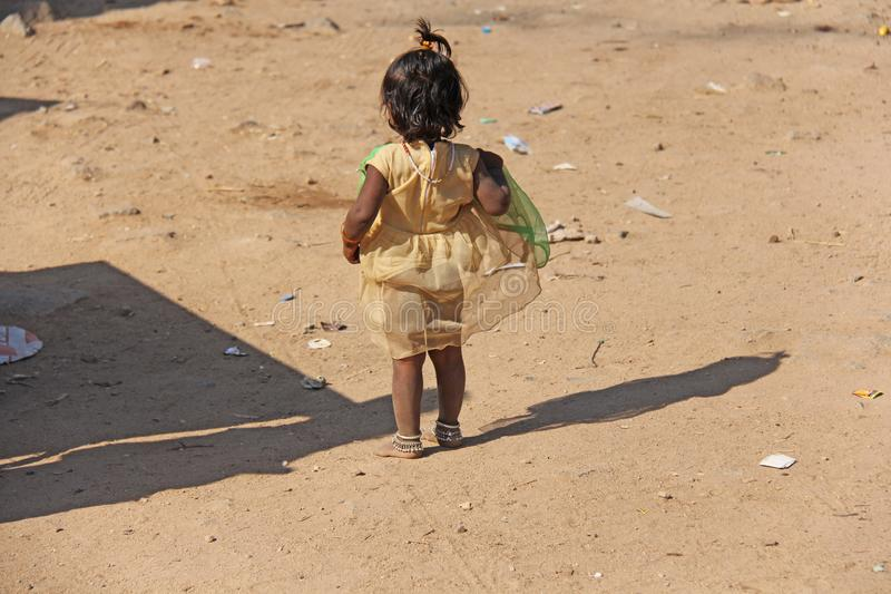 India, Hampi, 02 February 2018. A little poor girl in a dirty dress.  royalty free stock images