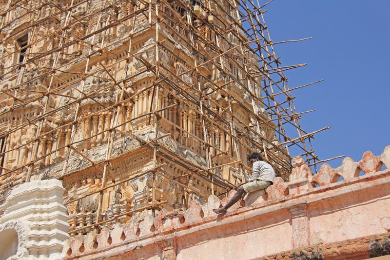 India, Hampi. February 1, 2018. The man restores Shiva Virupaksha Temple.  royalty free stock photo
