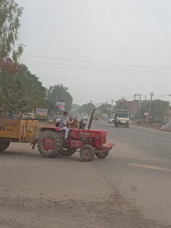 India haryana hisar city street. Indian , haryana, hisar city street chowk with tracktor vhichle with driving royalty free stock photos