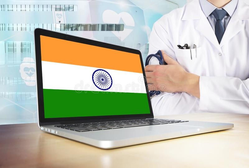 India healthcare system in tech theme. Indian flag on computer screen. Doctor standing with stethoscope in hospital. Cryptocurrency and Blockchain concept royalty free stock photography