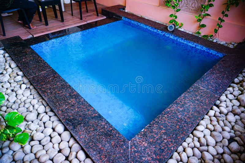 India - jaipur - hotel royal orchid - september 9, 2019, jacuzzi pool full of water. India - jaipur - hotel royal orchid - september 9, 2019, square shaped royalty free stock photos