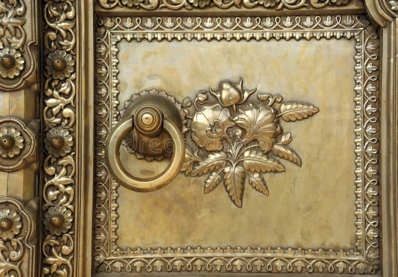 India Jaipur magnificent door. At the city palace; bronze work stock photos