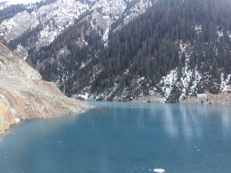 India jammu Kashmir Deep blue frozen water lake in kisnanganga River and steel Structure. India Jammu & Kashmir Kishanganga Hydroelectric Project dam site at royalty free stock photo