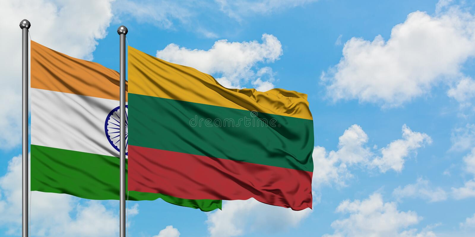 India and Lithuania flag waving in the wind against white cloudy blue sky together. Diplomacy concept, international relations. Waving in the wind against white royalty free stock photos