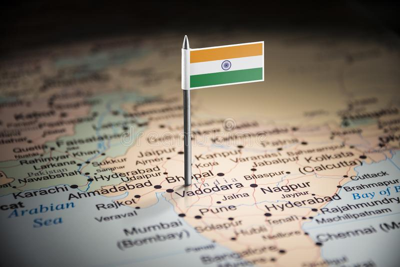 India marked with a flag on the map.  royalty free stock photos