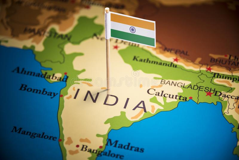 India marked with a flag on the map.  stock image