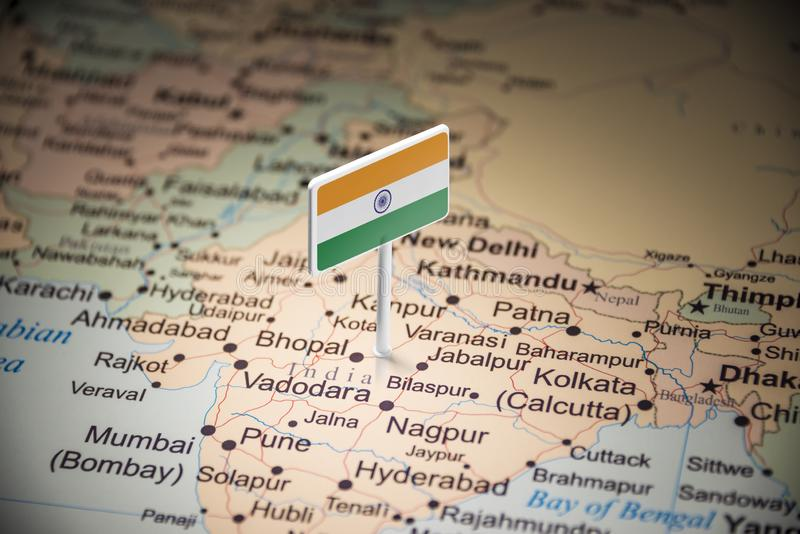 India marked with a flag on the map.  stock photography