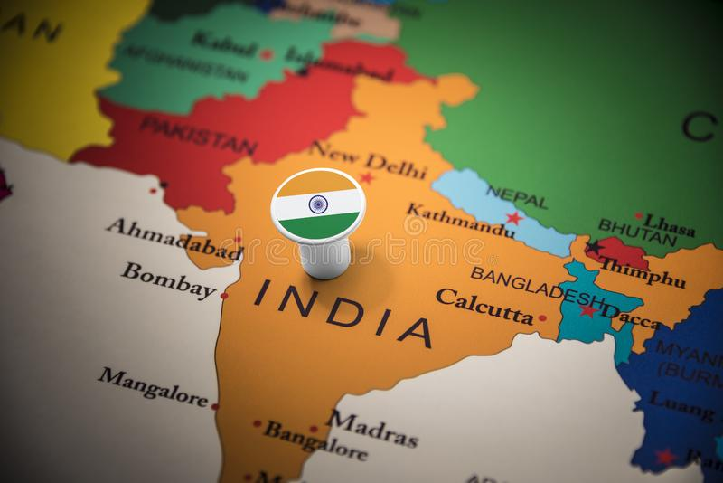 India marked with a flag on the map.  stock images
