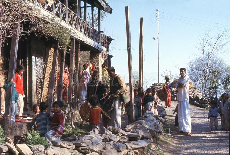 1977. India. Musicians singing and playing drums. The photo shows, two musicians, going from house to house, singing and playing drums, for a god harvest stock photos