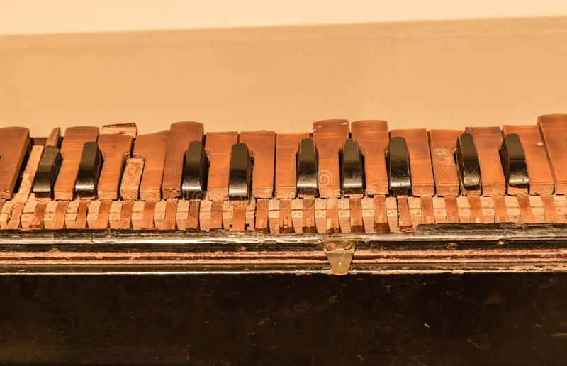 India old wood traditional piano keyboard closeup. View royalty free stock photography