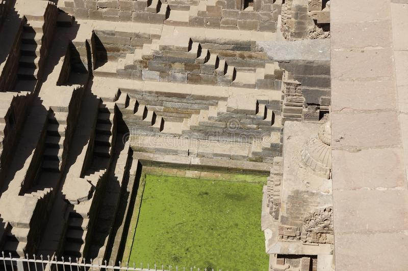 India - rajasthan - jaipur - dausa - chand baori - stepwell - march 28, 2018 green water appears in stepwell. India - rajasthan - jaipur - dausa - chand baori royalty free stock photos