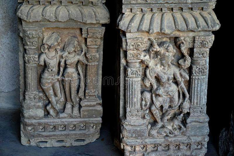 India - rajasthan - jaipur - march 28,2018 archeological relics sculpture, two pieces of broken stone with indian god images stock image