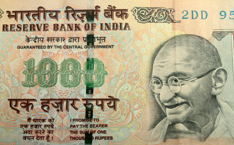 India Rupees. Extreme Close up of Indian Currency (Denomination 1000 rupees). Mahatma Gandhi's picture is designed inside this currency note stock photo