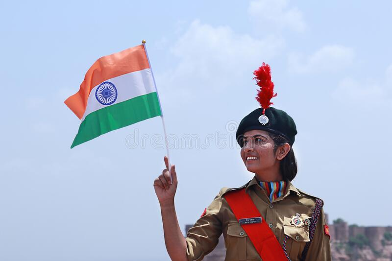 India`s National Cadet Corps NCC Lady Cadet Standing Holding Indian Flag, preparing for India. Delhi, India - 21St January 2019: India`s National Cadet Corps NCC stock photography