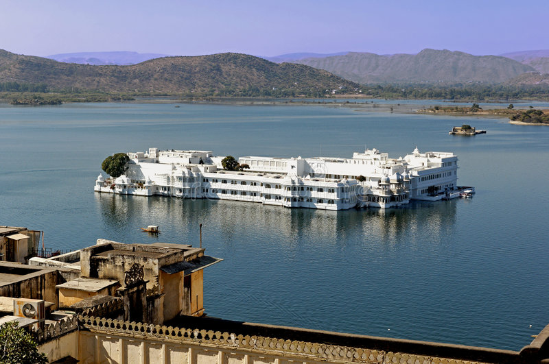 India, udaipur: lake palace. View of the famous palace today converted in heritage hotel ; the palace is situated in the heart of the lake pichola; a stock image