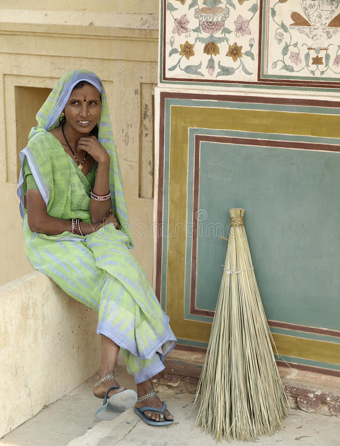 India woman have rest while sweeping stock photography