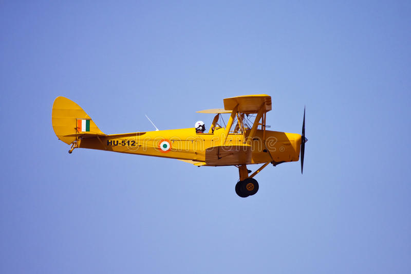 Indian Air Force Tiger Moth flying at Aero India royalty free stock image
