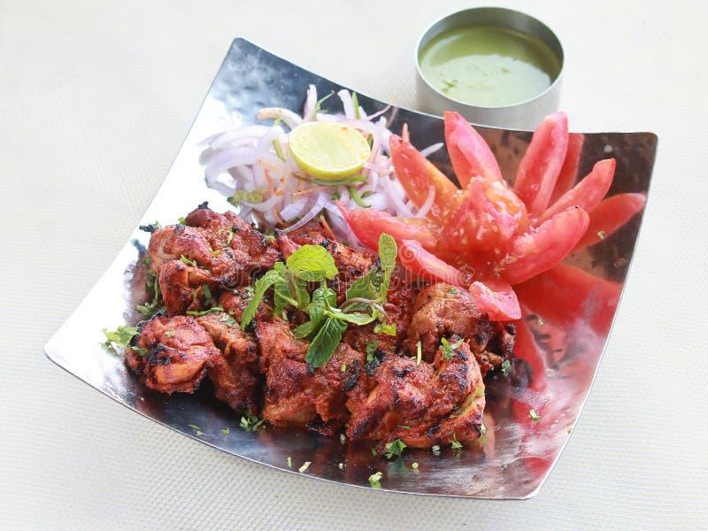 Indian appetizer Chicken tikka with salad & chutney stock photos